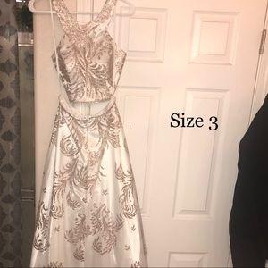 Beautiful white and glittery gold prom dress